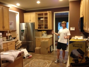 Drew unpacking the kitchen when we first moved