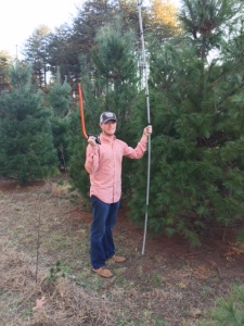 Drew all ready to cut down the Christmas tree